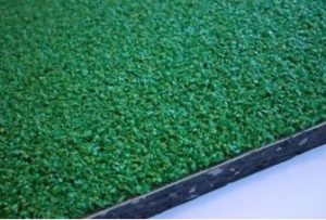 dettaglio piastell in gomma antitruma erba